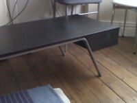 Black wooden Ikea coffee table with storage shelf at both ends
