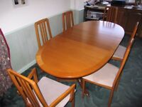 Teak Extending dining room table and 6 chairs