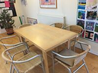 Extending dining table comfortable sits 6-8 people. Comes with 6 wicker chairs.