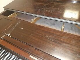 Baby grand piano in need of a of TLC