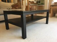 Dark brown glass topped coffee table