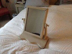 A painted beige dressing table mirror