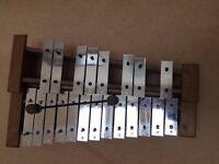 Xylophone with wood base and metal keys