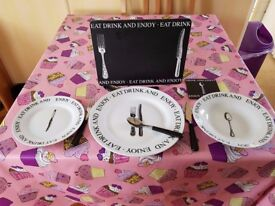 8 place settings in a lovely modern script design. Black and white