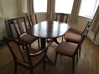 Extendable Oval shaped Dining Table dark wood with 6 chairs