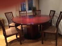 4' circular mahogany table, extends to 5' cloverleaf and 6 chairs