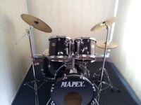 Retired drum teacher has a Mapex 'Venus' series drum kit for sale.