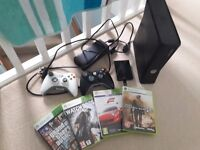 Xbox 360 slim console with 20gb hard drive and 2x controllers inc 4 top selling games