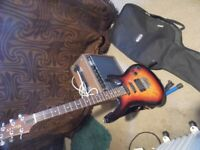 Wesley electric guitar, superstrat style, sunburst finish with gigbag, stand, and practise amp.