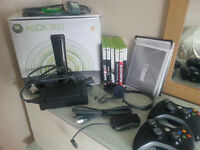 X box elite 120 GB. In the original box , all leads, 2 wireless controllers, head set and 6 games