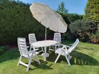 Hartman, table + 4 reclining chairs + parasol, quality manufacturer of garden dinning sets.