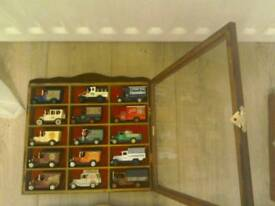 15 cars vans in 4 display cabinet with glass doors