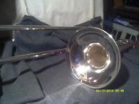 A CHEAP TROMBONE In SILVER PLATE IN V.G.C. SLIDES O.K.with MOUTHPIECE & CASE