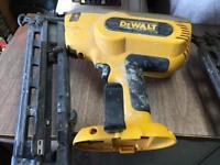 Two Dewalt nail guns .