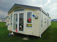Top of the Range Caravan with Direct Beach Access !!