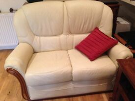 Lovely cream 2 seater leather sofa in excellent condition 185.00 pounds.Hardly used. With wood trim