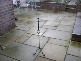 A tall black metal stand.