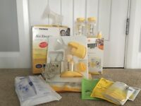 Medela mini electric breast pump- used. Extra accessories included. All good working order.