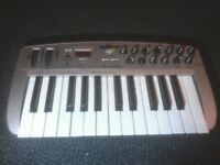 M-Audio Ozone Midi keyboard/controller. Mild cosmetic damage/no power cable. Pickup only!