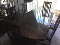 Dining room table and 6 chairs in gloss black