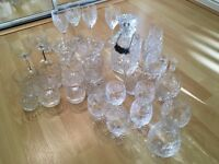 Crystal glasses. 9 whisky tumblers, 5 short stem medium size goblets plus many others