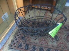 Ornate black metal cast log basket . Viewing and delivery available