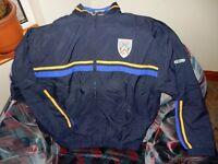 Coleraine Football club navy jacket, size small.