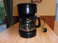A Filter COFFEE Maker ( X2682 ) Makes up to 12 cups