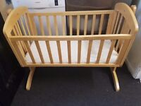 Lovely mamas and papas breeze crib in natural. The crib has a gentle swinging.Can be delivered.