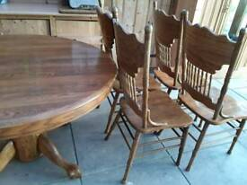 SOLID OAK ROUND PEDESTAL TABLE AND 4 CARVED CHAIRS SOLID HEAVY TABLE IS 48 INCHES DIAM