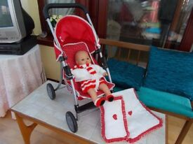 Doll and silver cross pushchair with a pram set.
