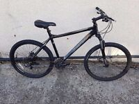 Carrera Avalanche mountain bike with 26 inch and 18 inch frame size.