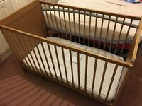 IKEA wooden cot with mattress and cover