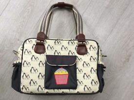 Yummy mummy pink lining penguin change bag