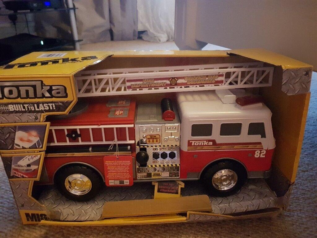 Tonka fire engine lights and siren noises.