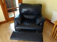 Natuzzi Italian leather recliner in navy blue. Unmarked condition just like new.