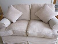 Comfy 2 seater sofa. All covers washable. Duck feather cushions. From smoke free home
