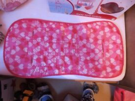 Pretty pink pushchair liner from Mothercare