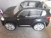 Black BMW child's ride on motorised car