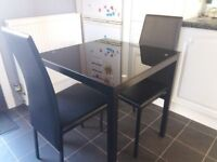 Glass dining table with 2 matching chairs