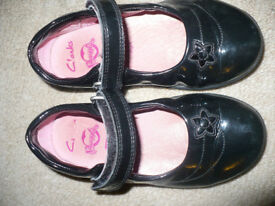 Girls Clarks Black Patent School Shoes size 8.5H (8 and 1/2 h), very good condition.