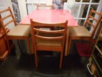 four matching ladder back vintage dining chairs