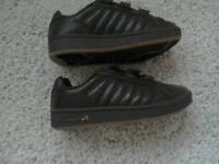 Childs brown Le coqsportif shoes