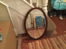 Medium oval vintage mirror. Lovely piece of furniture. Dark wood