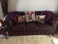Blood red three seater leather chesterfield