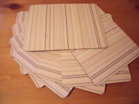 8 rectangular cork-baked placemats – muted yellow/oatmeal/brown stripe design. £4 ovno.