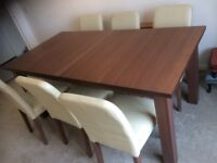Luxurious solid wood table seats 8-12 (easy to extend) with 6 faux leather comfy upholstered chairs