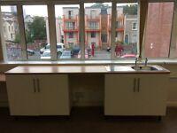 Kitchen sink, cupboard units & surface.