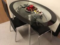 Silver and black table and 4 chairs
