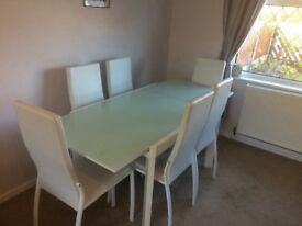 White extendable glass topped table and 6 chairs